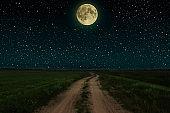 Beautiful magic night sky with fullmoon and stars  road receding