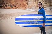 Surfer man enjoying vacation