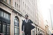 Businessman using phone outdoors