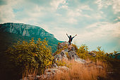 Woman on the mountain with arms outstretched