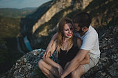 Couple sitting on the cliff