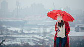 Charming lady with red umbrella
