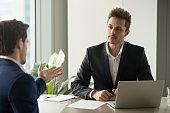 Focused businessman listening partners good offer