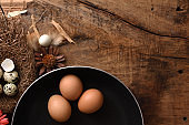 studio shot of quail eggs on a vintage wooden background