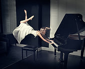 Woman floating while playing piano