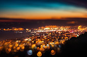 Tilt shift blur effect. Night aerial view panorama of Varna