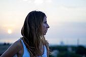 spanish woman watching Barcelona landscape when sunrise