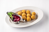 Deep fried cheese balls with sauce, isolated on white plate