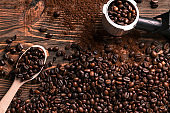 Coffee beans on wooden table texture with copy space. View from