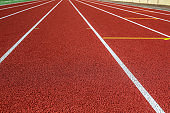 Red treadmill in sport field