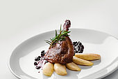 Food. Duck leg with pear and currant sauce. Delicatessen Gourmet Restaurant Menu Concept