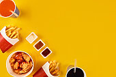 Fast food dish on yellow background. Fast food set fried chicken and french fries. Take away fast food