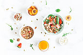 Breakfast with muesli, strawberry salad, fresh fruit, orange juice, nuts