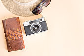 Film camera and wallet on yellow background,top view