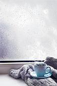 cozy soft gray blanket with a cup of coffee
