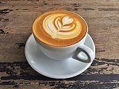 Cup of latte art on wooden backgrounds
