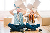 Couple sitting in yoga pose, moving to new house
