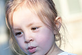 Young girl outside looking away