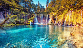 Majestic view on turquoise water and sunny beams in the Plitvice Lakes National Park. Croatia.