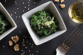 Fresh seaweed salad in a square bowl