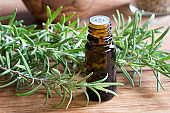 A bottle of rosemary essential oil