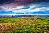 Typical Icelandic landscape with foggy mountains on the horizon