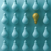 Think different concept , One yellow light bulb stand out from unlit green incandescent lightbulbs with shade and shadow , individuality and different business creative idea concept. 3D render