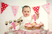 Beautiful happy baby on first birthday background.