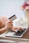 Women is shopping online with laptop