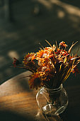 Flowers at table in cafe and sunlight with film color tone effect