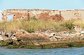 Ruin of a destroyed old brick home in the venetian lagoon