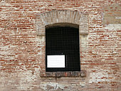Window of an old building with iron grilles
