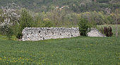 Drywall made of stones in the middle of the meadow