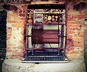 old well in stonework with rusty chain