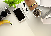 Top down view of modern work space office desk with essentials
