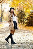 A pretty teenage female in an autumn park