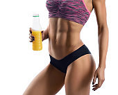 Fitness woman with a bottle of juice