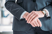 Close-up partial view of hands of senior businesswoman in formal wear