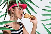 fashionable woman eating ice cream