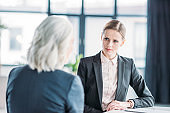 two businesswomen discussing business project on meeting in office