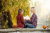A woman enjoying a warm day in park whith her daughter