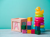 Baby toys on wooden table