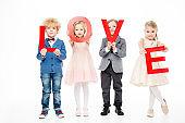 Kids holding word love
