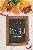 restaurant menu and fresh vegetables