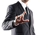 cropped view of businessman in suit pointing with finger, isolated on white