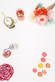 top view of refreshing lemonades, decorative flowers and macarons isolated on white