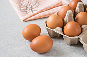 Eggs with carton of egg and wire whisk