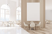 White and wood luxury cafe with a poster