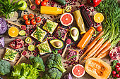 Healthy vegan food. Sandwiches and fresh vegetables on wooden background. Detox diet. Different colorful fresh juices. top view
