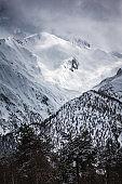 Panoramic view on snow winter mountains and cloud sky. Caucasus Mountains. Svaneti region of Georgia.